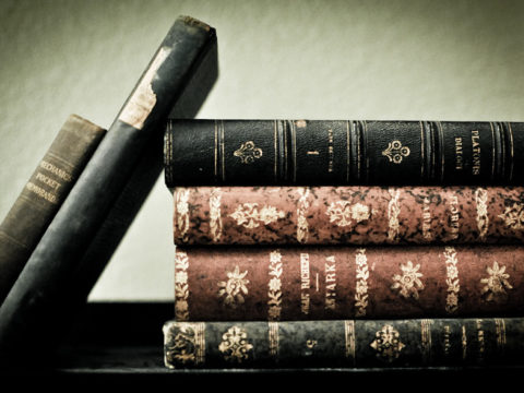 """Old Books"" by kraybon is licensed under CC BY-NC-SA 2.0"